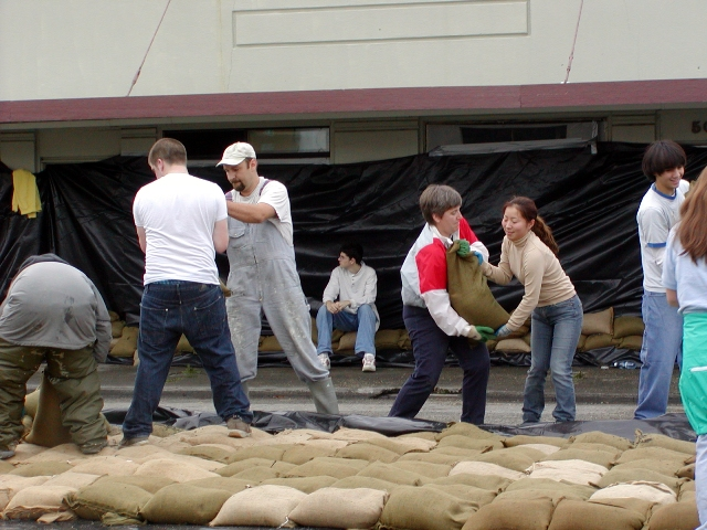 Volunteers helping to build a sandbag wall in downtown mount vernon